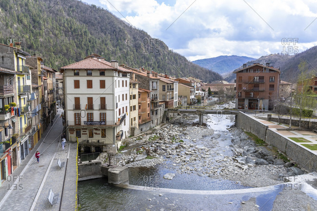 April 4, 2019: europe, spain, catalonia, girona, ripollès, camprodon, view from the pont nou bridge to the historic center of camprodon on the ter river