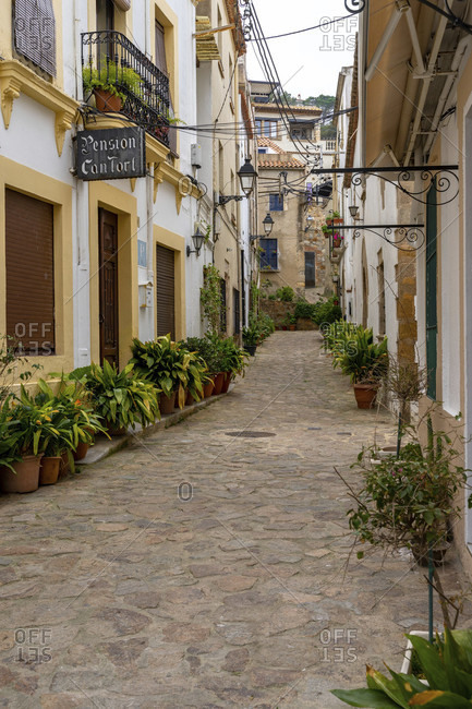 April 2, 2019: europe, spain, catalonia, gerona province, la selva, tossa de mar, narrow street in the old town of tossa de mar