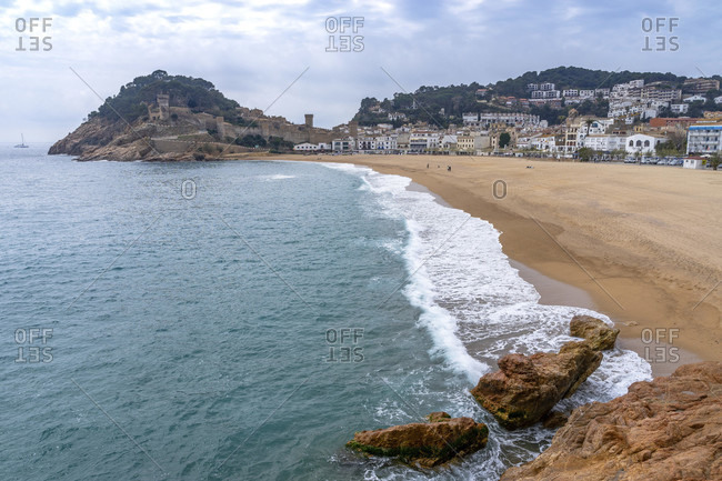 Europe, spain, catalonia, gerona province, la selva, tossa de mar, view of tossa de mar beach and the fortress on the hill at its end
