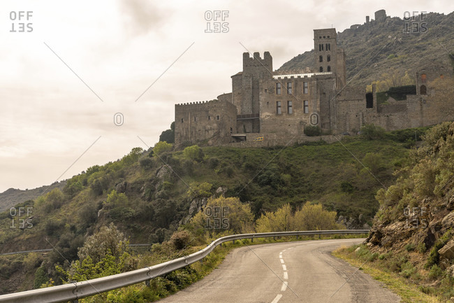 Europe, spain, catalonia, girona, alt emporda, port de la selva, valley-side view of the old benedictine monastery sant pere de rodes in the hinterland of the costa brava