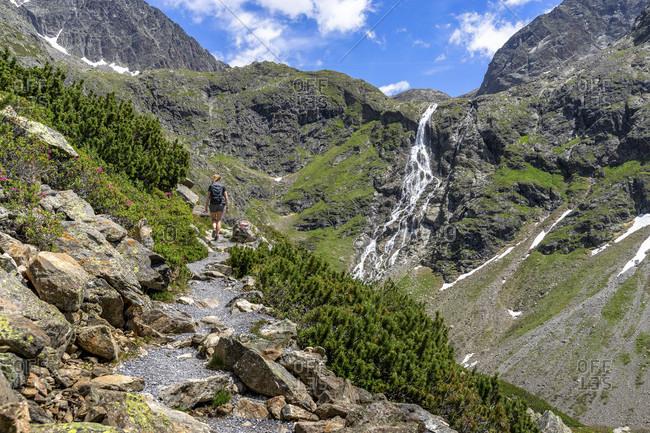 Europe, austria, tyrol, otztal alps, otztal, gries im sulztal, mountain hiker ascending to the winnebachsehutte in sellrain