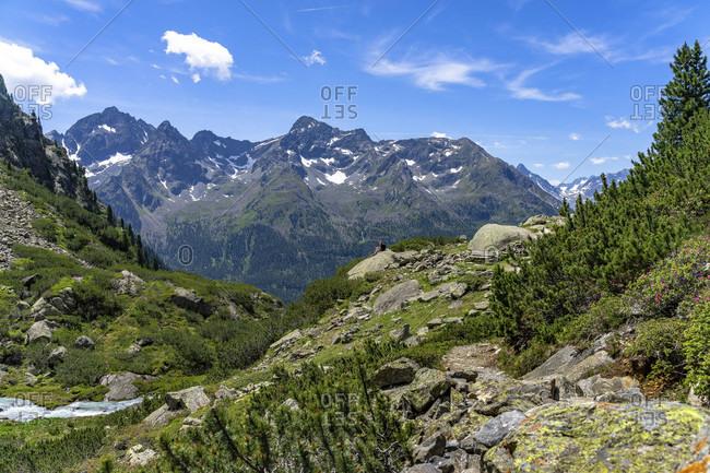 Europe, austria, tyrol, otztal alps, otztal, gries im sulztal, winnebachsehutte, mountain hiker enjoys the view of the sulztalkamm