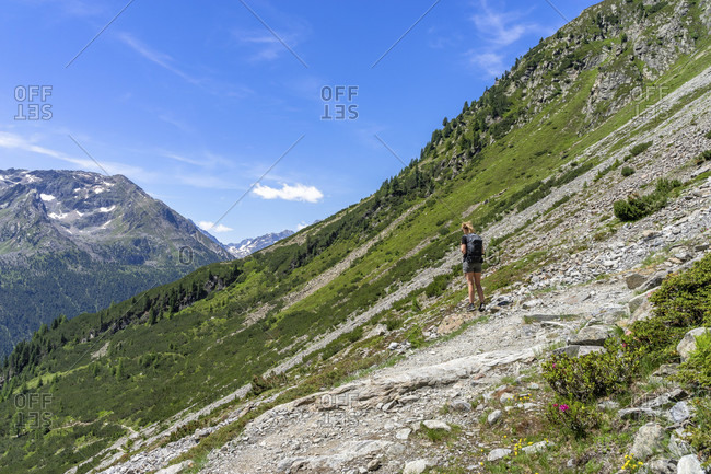 Europe, austria, tyrol, otztal alps, otztal, gries im sulztal, wanderin enjoys the view on the way to the winnebachsehutte