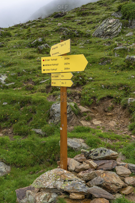 July 31, 2019: europe, austria, tyrol, otztal alps, otztal, umhausen, signpost below the kreuzjochspitze in the otztal