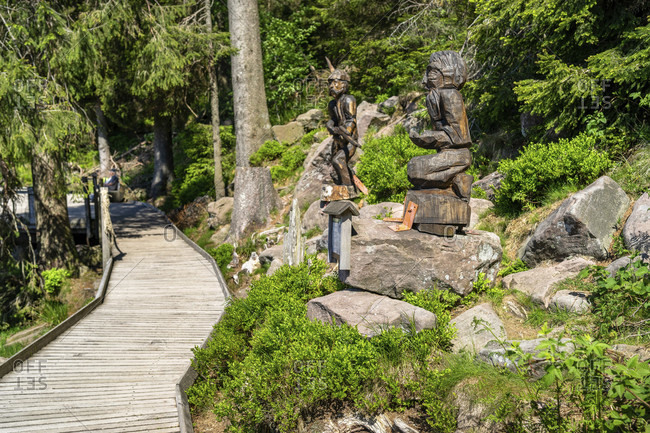 June 3, 2019: europe, germany, baden-wuerttemberg, black forest, hiking trail around mummelsee with wooden sculptures