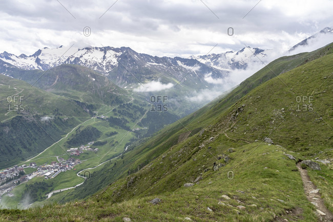 Europe, austria, tyrol, otztal alps, otztal, view over a steep mountain slope down to obergurgl and the surrounding mountains