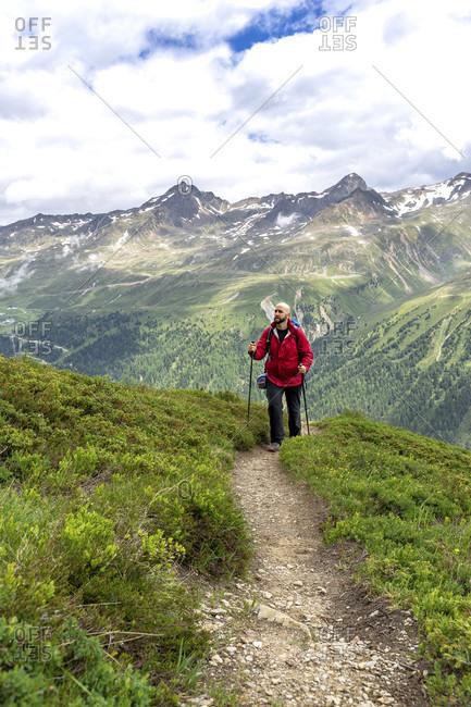 Europe, austria, tyrol, otztal alps, otztal, hikers on the otztaler urweg in front of mountain panorama
