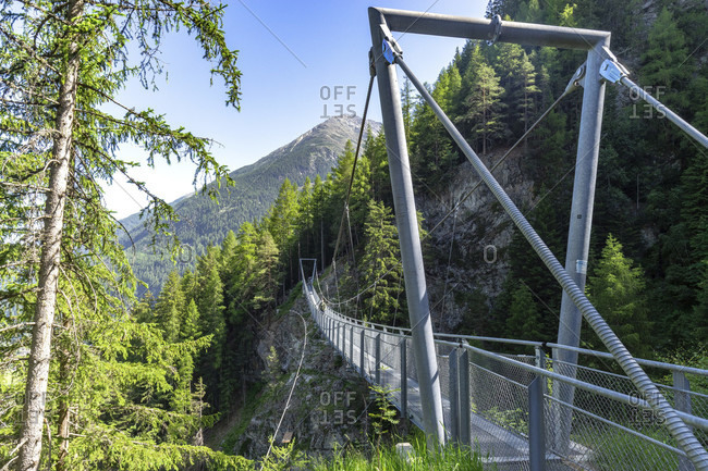 Europe, austria, tyrol, otztal alps, otztal, hikers crosses the längenfeld suspension bridge between brand and burgstein