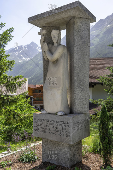 June 26, 2019: europe, austria, tyrol, otztal alps, otztal, saint figure by johannes nepomuk in längenfeld