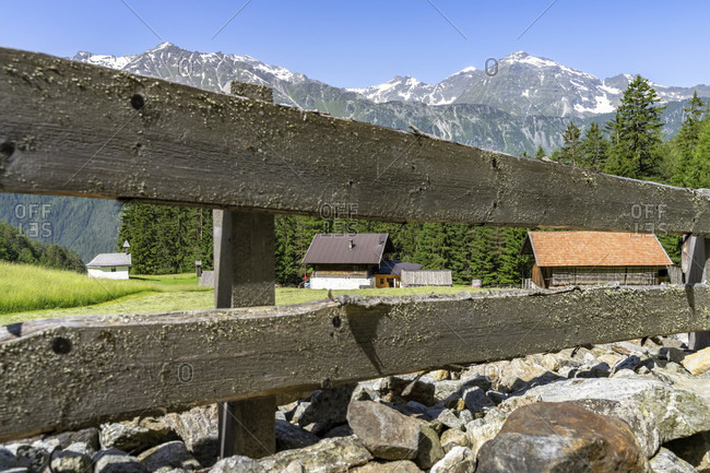Europe, austria, tyrol, otztal alps, otztal, view through a wooden fence to a farm in niederthai