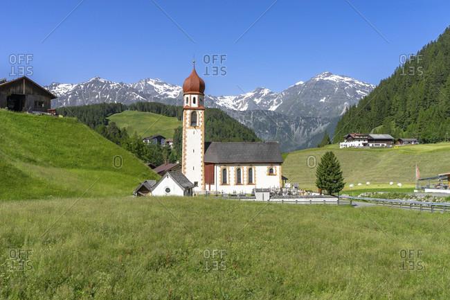 Europe, austria, tyrol, otztal alps, otztal, view of the parish church in niederthai against a mountain backdrop