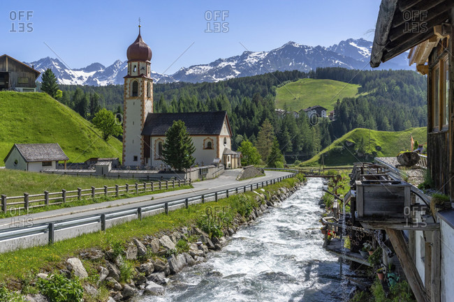 Europe, austria, tyrol, otztal alps, otztal, alte muhle am horlachbach and parish church in the mountain village of niederthai near umhausen