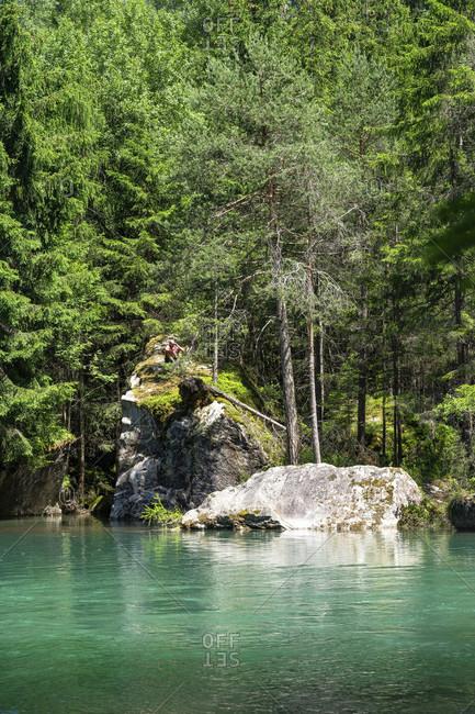 Europe, austria, tyrol, otztal alps, otztal, man sitting on rock at habicher see