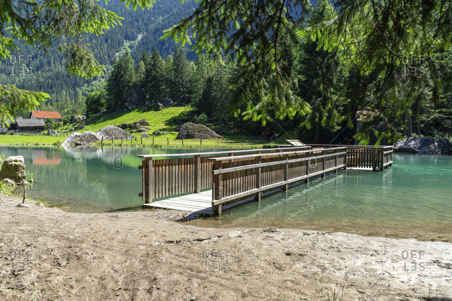 Europe, austria, tyrol, otztal alps, otztal, wooden footbridge at habicher see near habichen