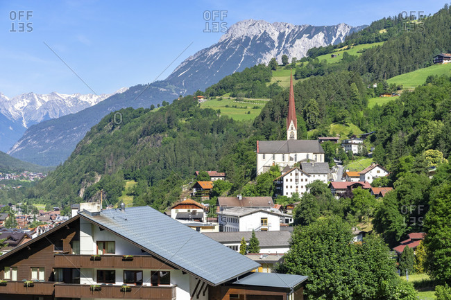 Europe, austria, tyrol, otztal alps, otztal, view of oetz with its parish church and the tschirgant in the background