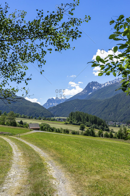 Europe, austria, tyrol, otztal alps, otztal, wide view over the summer meadows towards umhausen