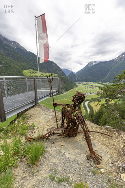 June 20, 2016: europe, austria, tyrol, otztal alps, otztal, devil sculpture at teufelskanzel viewpoint above the otztal