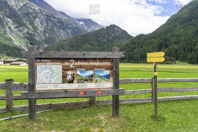 June 16, 2019: europe, austria, tyrol, otztal alps, otztal, information board for hikers at huben