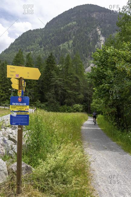 June 15, 2019: europe, austria, tyrol, otztal alps, otztal, forest path along the otztaler ache between otztal train station and oetz