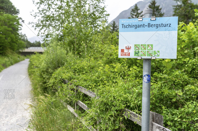 June 15, 2019: europe, austria, tyrol, otztal alps, otztal, otztal train station, sign on forest path near otztal train station