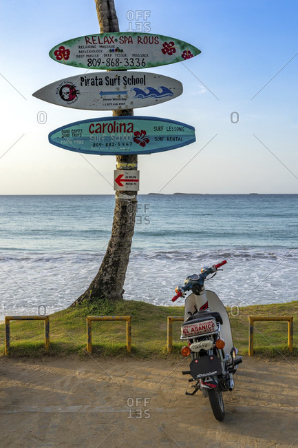September 2, 2019: america, caribbean, greater antilles, dominican republic, samana province, las terrenas, playa bonita, moped in front of the sea on playa bonita beach
