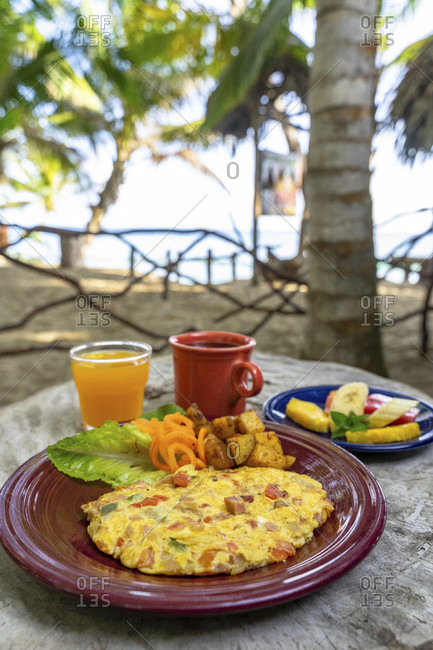 America, caribbean, greater antilles, dominican republic, cabarete, breakfast on the beach at the natura cabana boutique hotel & spa