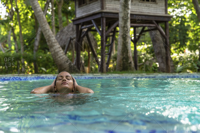 America, caribbean, greater antilles, dominican republic, cabarete, woman in the pool of the natura cabana boutique hotel & spa