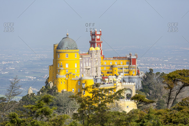 The Palacio Nacional da Pena is a castle in the Portuguese city of Sintra. It was built on the ruins of a monastery after 1840 on behalf of the Portuguese titular king and consort Ferdinand II
