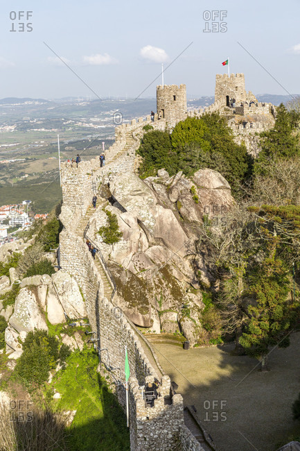 The Castelo dos Mouros is the ruin of a castle complex, which is located in the forest above the Portuguese city of Sintra