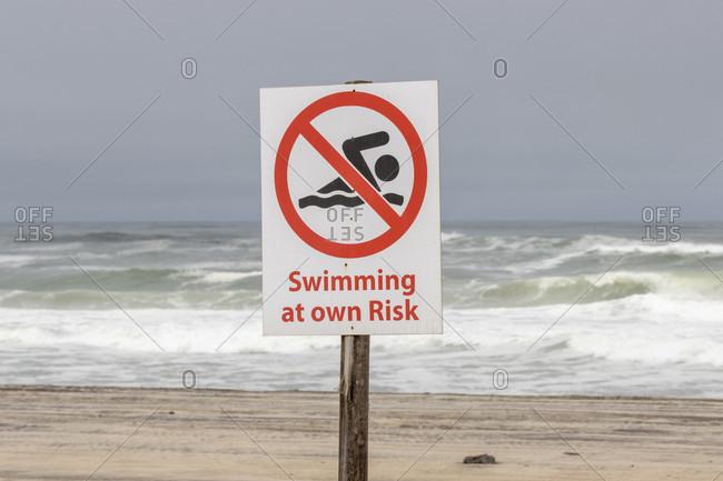 Swimming prohibited warning sign, Skeleton Coast Park, Namibia