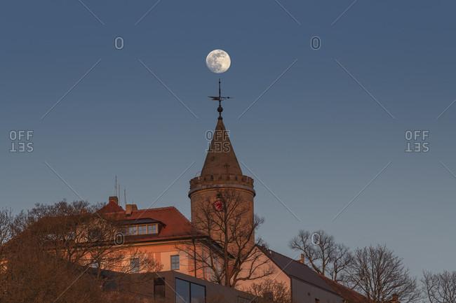 Sunset and moonrise at the Leuchtenburg in Thuringia