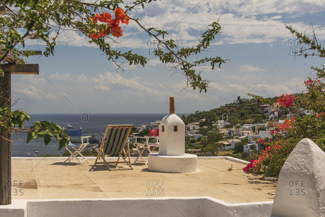 Sicily - Sunny impressions of the Aeolian Islands, View over a roof terrace to Panarea.