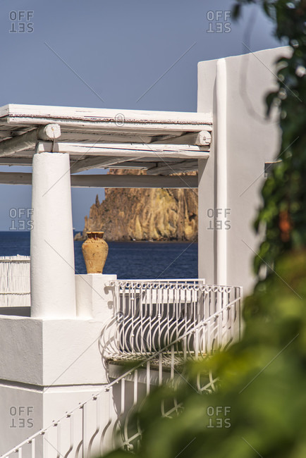 Sicily - Sunny impressions of the Aeolian Islands, view of Lisca Bianca over a roof terrace with terracotta amphora, Panarea.