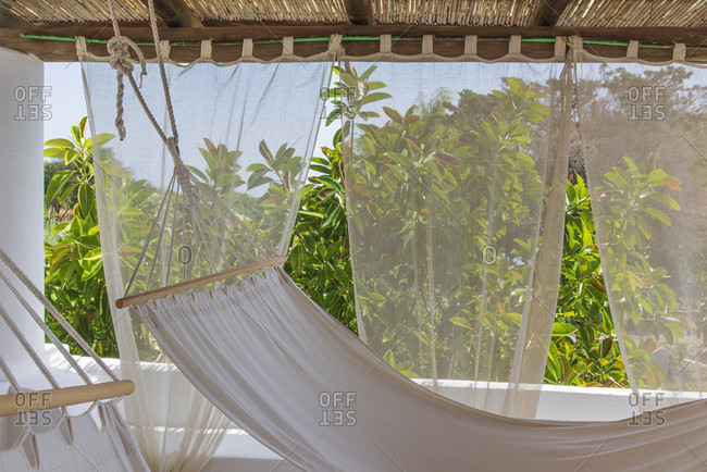 Sicily - Sunny impressions of the Aeolian Islands, two hammocks in a luxury apartment on Salina with a view of Lipari.