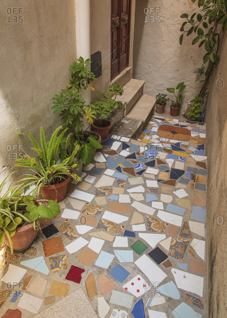 Sicily - Sunny impressions of the Aeolian Islands, Tile mosaic in a small courtyard, Lipari town.