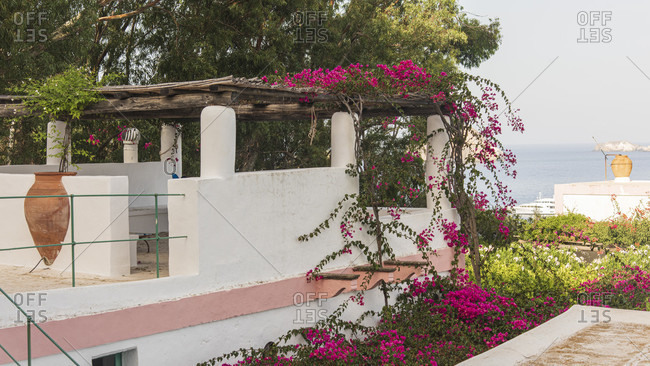 Sicily - Sunny impressions of the Aeolian Islands, Nice roof terrace with pergola and walled amphora.