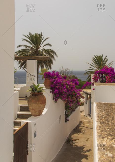 Sicily - Sunny impressions of the Aeolian Islands, Nice alley towards the beach, Panarea.