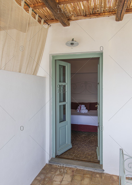 Sicily - Sunny impressions of the Aeolian Islands, glance into the bedroom of a luxury apartment on the island of Salina.