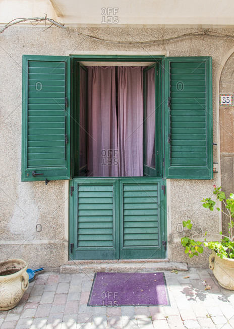 Sicily - Sunny impressions of the Aeolian Islands, Colorful front door with curtain, Lipari town.