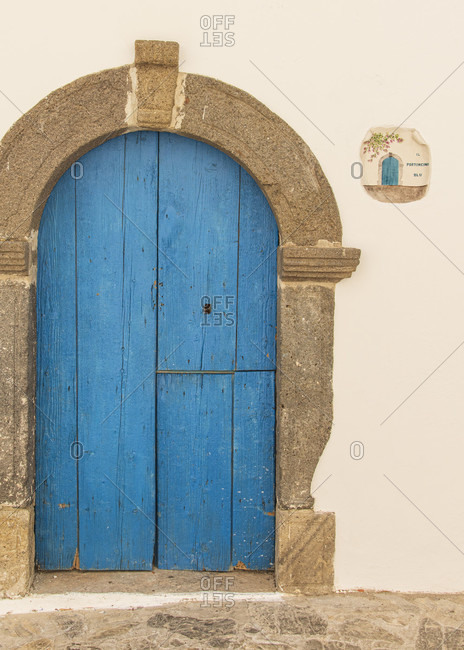 Sicily - Sunny impressions of the Aeolian Islands, Blue wooden door in the arch, panarea.