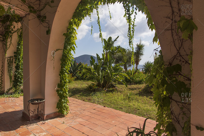 Sicily - Sunny impressions of the Aeolian Islands, Arch overgrown with vines; Lipari.
