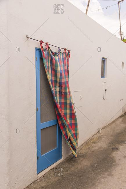 Sicily - Sunny impressions of the Aeolian Islands, also known as Aeolian Islands or Isole Eolie: Lipari, Stromboli, Salina, Vulcano, Panarea, Filicudi and Alicudi. Typical door curtain on Panarea.