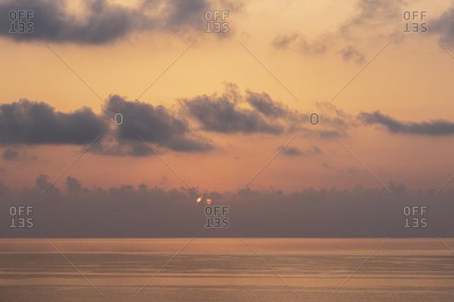 Sicily - Sunny impressions of the Aeolian Islands, also known as Aeolian Islands or Isole Eolie: Lipari, Stromboli, Salina, Vulcano, Panarea, Filicudi and Alicudi. Sunrise before Lipari.