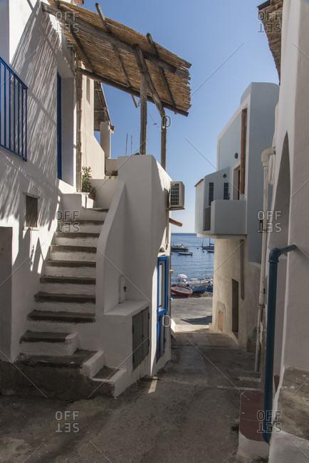 Sicily - Sunny impressions of the Aeolian Islands, also known as Aeolian Islands or Isole Eolie: Lipari, Stromboli, Salina, Vulcano, Panarea, Filicudi and Alicudi. Narrow alley for more, Filicudi.