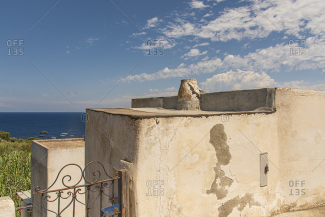Sicily - Sunny impressions of the Aeolian Islands, also known as Aeolian Islands or Isole Eolie: Lipari, Stromboli, Salina, Vulcano, Panarea, Filicudi and Alicudi. Facade of houses in Panarea.