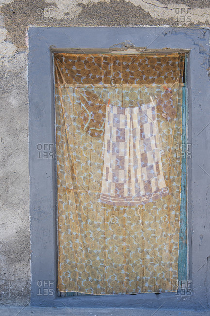 Sicily - Sunny impressions of the Aeolian Islands, also known as Aeolian Islands or Isole Eolie: Lipari, Stromboli, Salina, Vulcano, Panarea, Filicudi and Alicudi. Beach towel in a window.