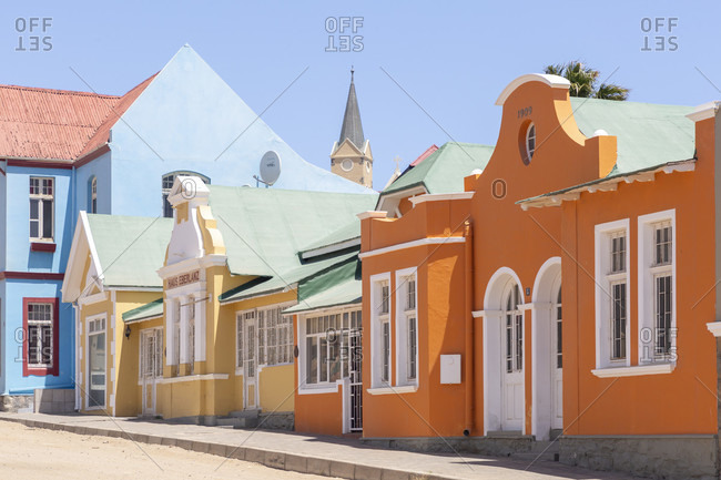 Several colorful historical buildings stand side by side on Berg Street, Luderitz