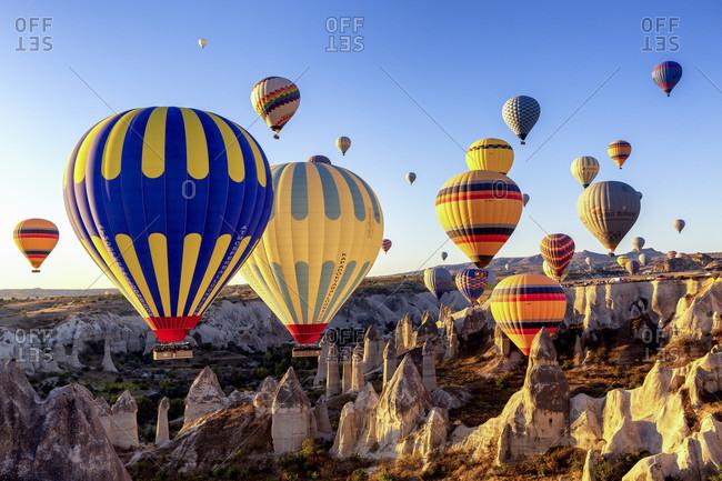 September 29, 2019: Hot air balloon in the morning in the eroded landscape near Goreme, Cappadocia, Anatolia, Turkey