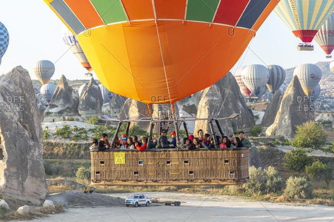 September 27, 2019: Hot air balloon in the morning in the eroded landscape near Goreme, Cappadocia, Anatolia, Turkey
