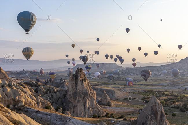 September 26, 2019: Hot air balloon in the morning in the eroded landscape near Goreme, Cappadocia, Anatolia, Turkey